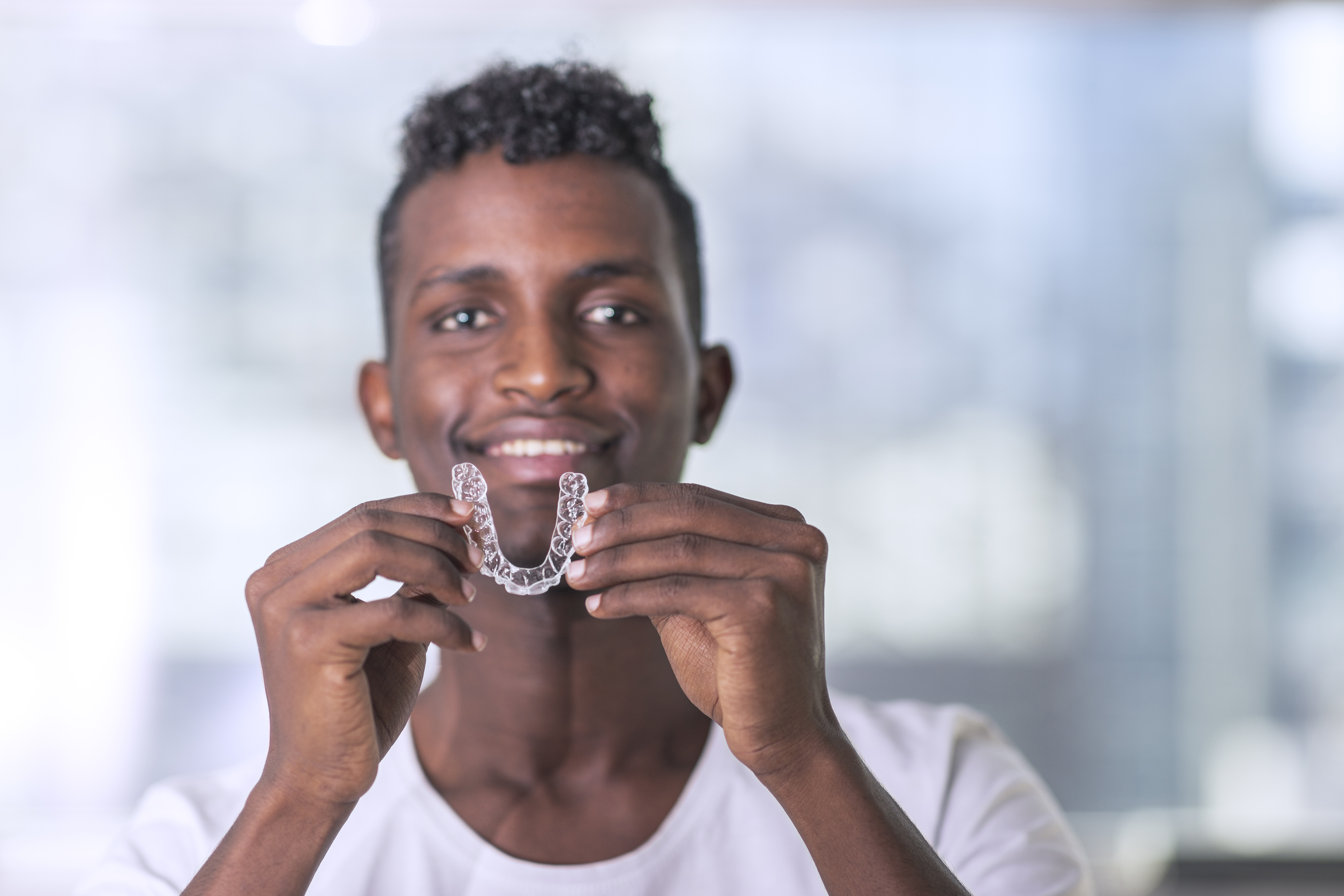 man with Invisalign aligners